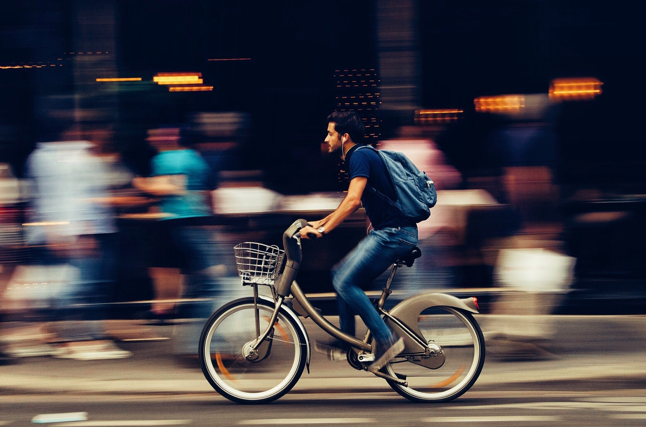 Man on electric bike in city